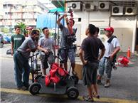 Ah Hung (Key Grip) rigging the camera for a chase sequence